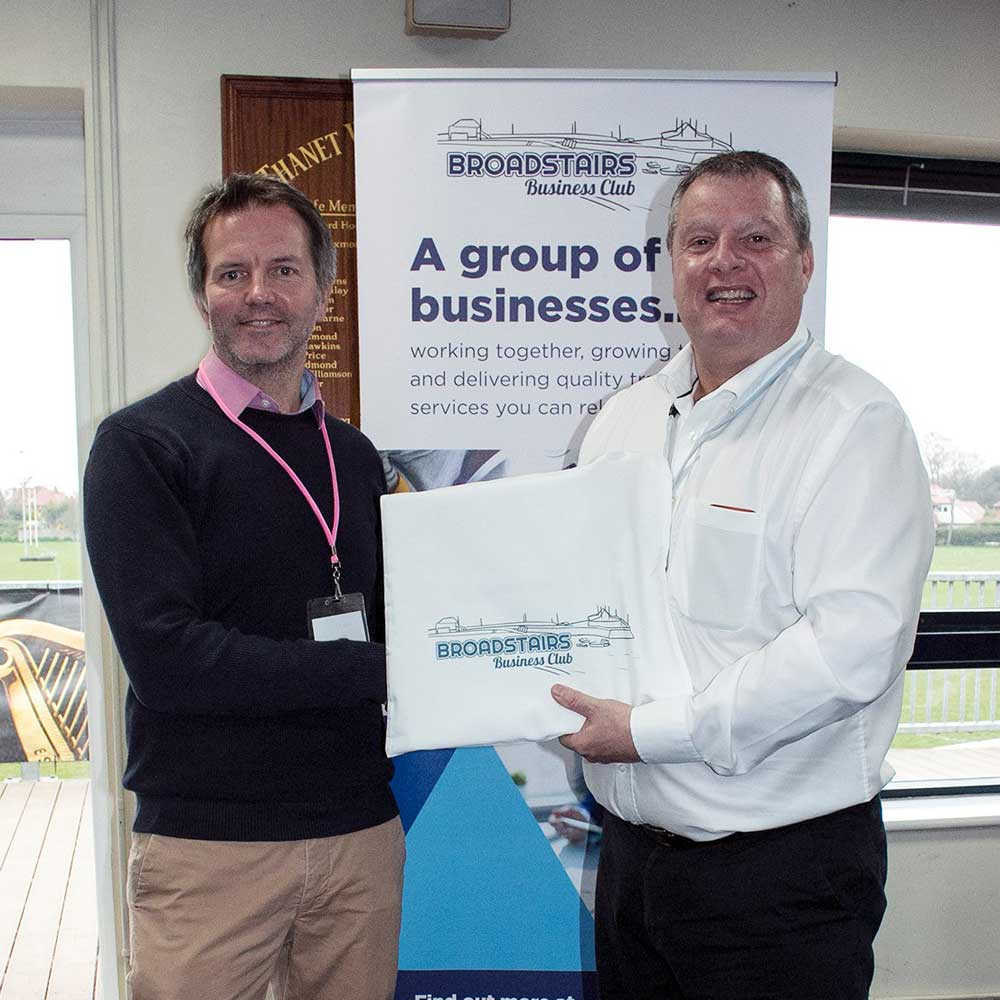 Photo of Steve Fuller, Kent Mentor Support receiving his membership manual from chairman, Mike Chance