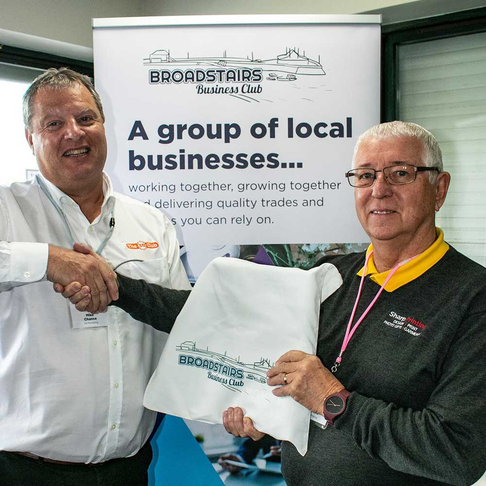 Photo of Lionel Sharp, Sharp Printing receiving his membership manual from chairman, Mike Chance