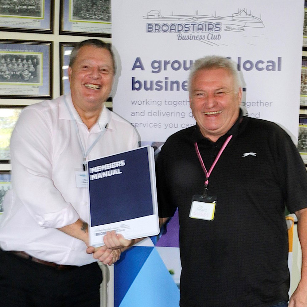 Photo of Tim Barkes, TMi Roof Coatings receiving his membership manual from chairman, Mike Chance